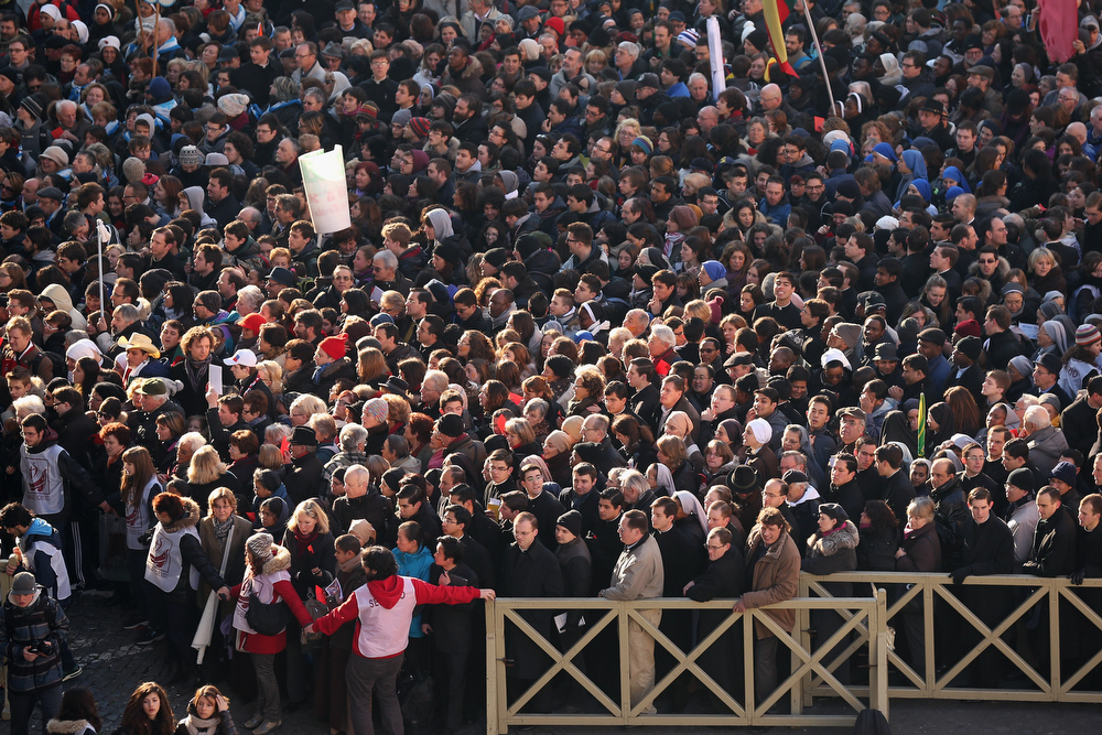 Description of . Pilgrims queue to enter St Peter\'s Square before Pope Benedict XVI\'s final weekly public audience on February 27, 2013 in Vatican City, Vatican.  The Pontiff has attended his last weekly public audience before stepping down tomorrow. Pope Benedict XVI has been the leader of the Catholic Church for eight years and is the first Pope to retire since 1415. He cites ailing health as his reason for retirement and will spend the rest of his life in solitude away from public engagements.  (Photo by Oli Scarff/Getty Images)
