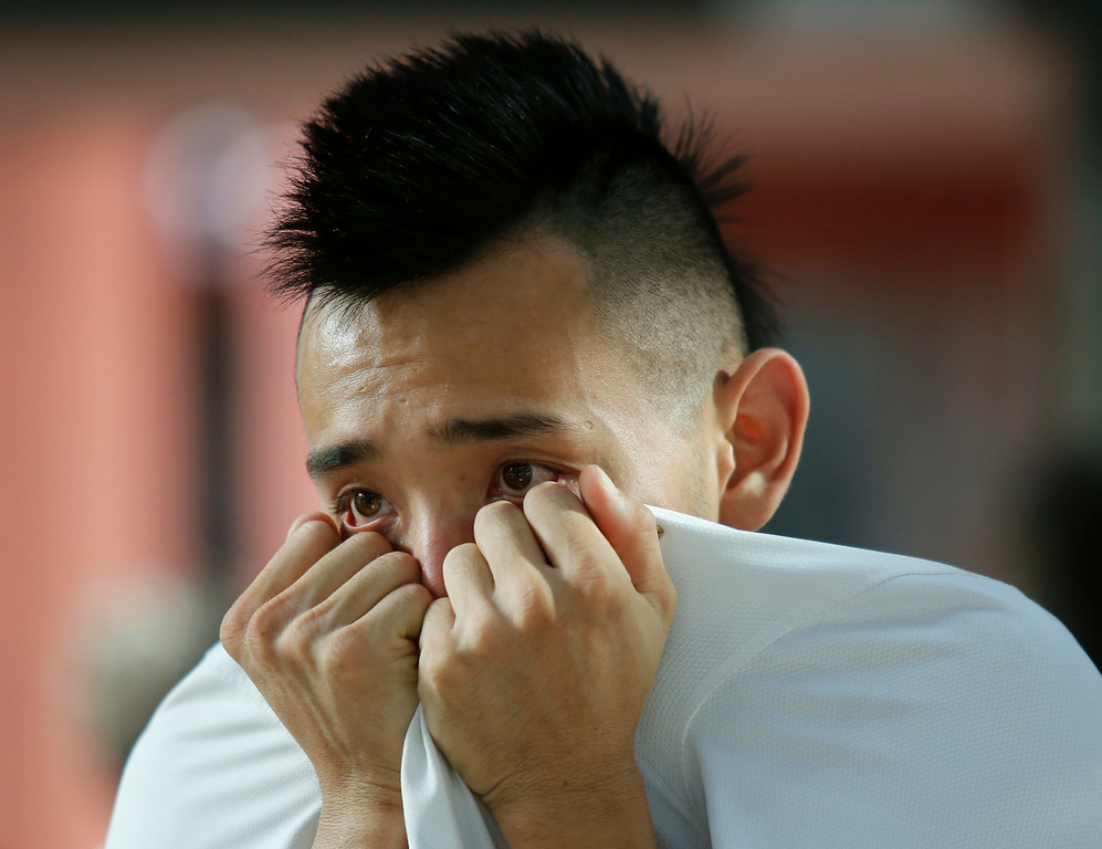 . John Ying watches in Chattanooga, Tenn., as Belgium defeats the United States in their World Cup soccer match in overtime Tuesday, July 1, 2014. (AP Photo/Chattanooga Times Free Press, Doug Strickland)