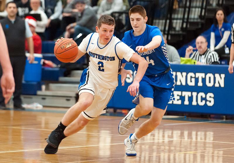 12/18/18  Wesley Bunnell | Staff  Southington basketball vs Glastonbury at Southington High School on Tuesday night. Ryan Gesnaldo (2)j brings the ball downcourt.