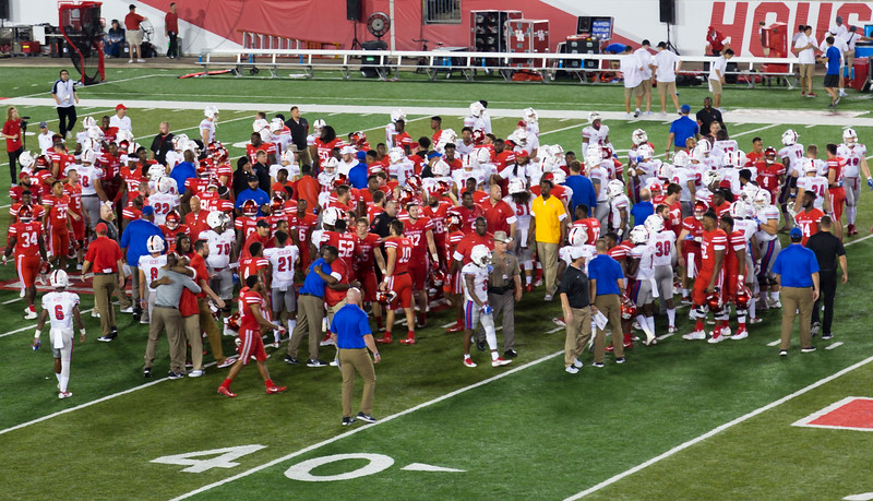 The teams mix and shake hands after well-fought game.