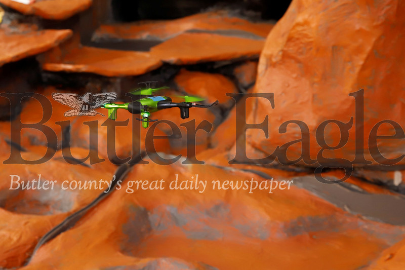 A drone from Drone Addiction flies through a martian landscape created by Mars High School students. Seb Foltz/Butler Eagle