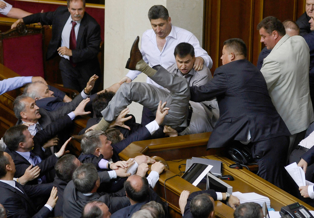 . In this may 24, 2012 file photo, lawmakers scuffle from pro-presidential and oppositional factions in the parliament session hall in Kiev, Ukraine. The hall erupted over a bill that would allow the use of the Russian language in courts, hospitals and other institutions in the Russian-speaking regions of the country. (AP Photo/Maks Levin, File)