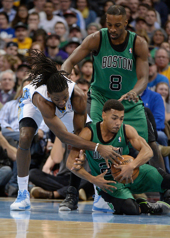 . Denver Nuggets power forward Kenneth Faried (35) dives after a loose ball with Boston Celtics point guard Phil Pressey (26) during the fourth quarter  January 7, 2014 at Pepsi Center. (Photo by John Leyba/The Denver Post)