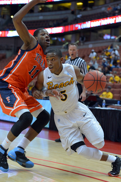 . LBSU\'s Mike Caffey drives around CSUF\'s Josh Gentry at the Honda Center in Anaheim, CA on Thursday, March 13, 2014. Long Beach State vs CSU Fullerton in the Big West men\'s basketball tournament. 2nd half. LBSU won 66-56.  Photo by Scott Varley, Daily Breeze)