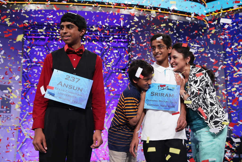. Sriram Hathwar (R) of Painted Post, New York is greeted by family members after he and Ansun Sujoe (L) of Fort Worth, Texas both won the 2014 Scripps National Spelling Bee competition May 29, 2014 in National Harbor, Maryland. Hathwar and Sujoe were declared as co-champions after 22 rounds of the competition.  (Photo by Alex Wong/Getty Images)