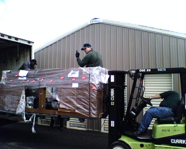Unloading the stand.. Try to ignore Bryans hand signal...  Sent from my Sidekick -gc