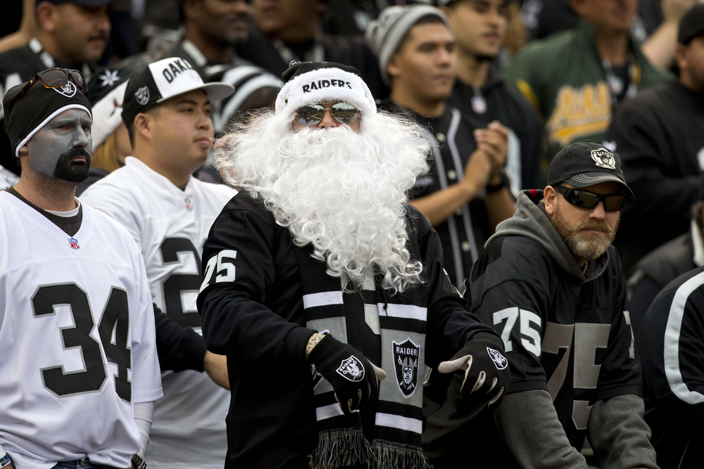 Description of . An Oakland Raiders fan dressed as Santa Claus in the stands during the second quarter against the Kansas City Chiefs at O.co Coliseum on December 16, 2012 in Oakland, California.  (Photo by Jason O. Watson/Getty Images)