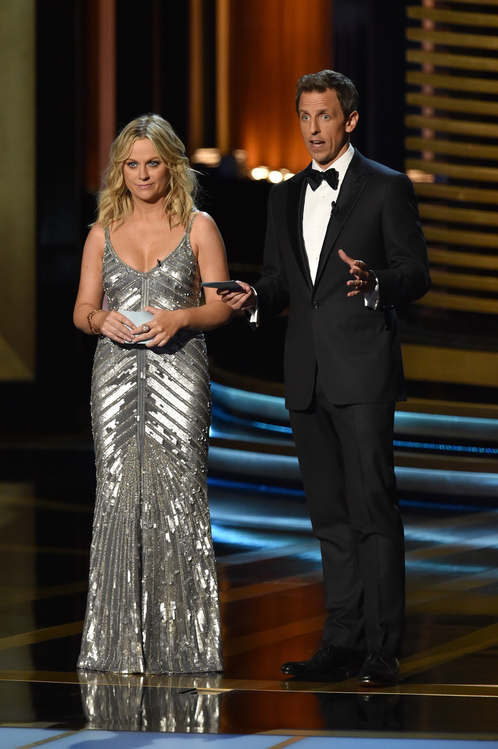 . Actress Amy Poehler (L) and host Seth Meyers speak onstage at the 66th Annual Primetime Emmy Awards held at Nokia Theatre L.A. Live on August 25, 2014 in Los Angeles, California.  (Photo by Kevin Winter/Getty Images)