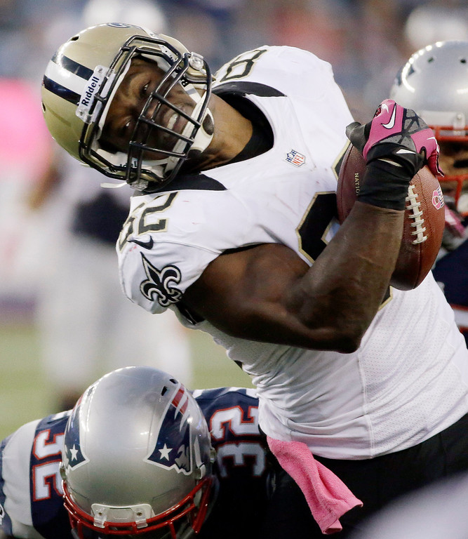 . New England Patriots free safety Devin McCourty (32) tackles New Orleans Saints tight end Benjamin Watson (82) after a catch in the third quarter of an NFL football game Sunday, Oct.13, 2013, in Foxborough, Mass. (AP Photo/Stephan Savoia)