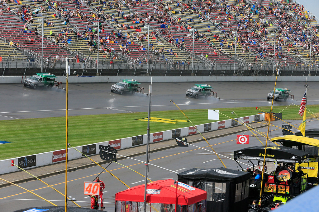 . Air Titans dry the track during the NASCAR Sprint Cup series auto race at Michigan International Speedway, Sunday, June 14, 2015, in Brooklyn, Mich. (AP Photo/Carlos Osorio)