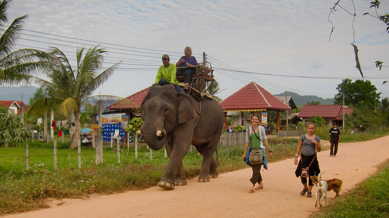 Ana and I walk back from our elephant trek in Hongsa, Laos.