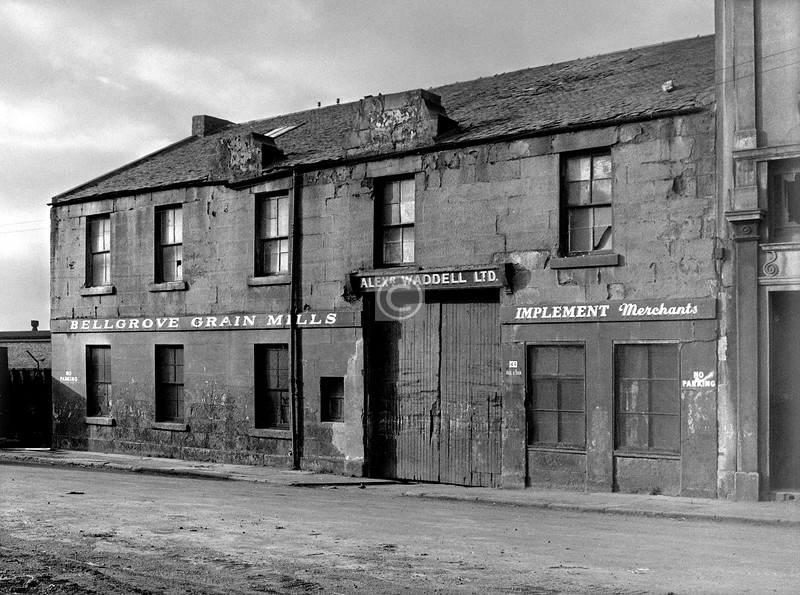 Wesleyan St, west side.  A curiously country-town scene not 100 yards from the Gallowgate. This was built in 1859 as a wire works for W. Riddell & co.    February 1976