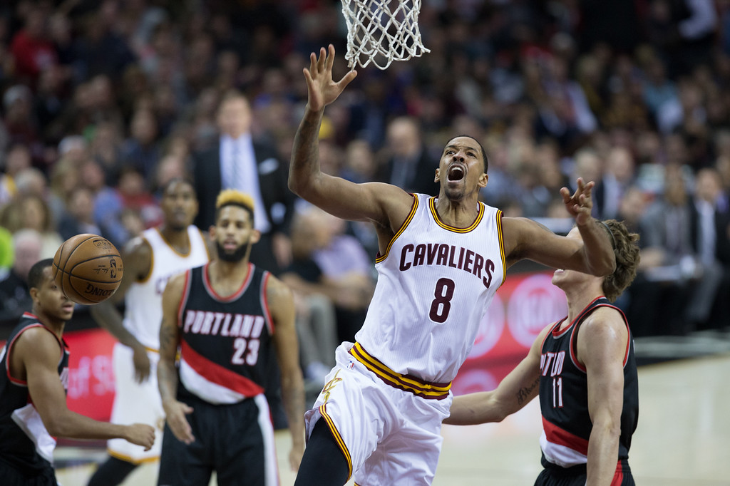 . Michael Johnson - The News-Herald Channing Frye of the Cleveland Cavaliers draws a foul during Kyrie Irving (2) of the Cleveland Cavaliers goes up for a layup against Meyers Leonard during a home game against the Portland Trailblazers on November 23, 2016 at the Quicken Loans Arena.