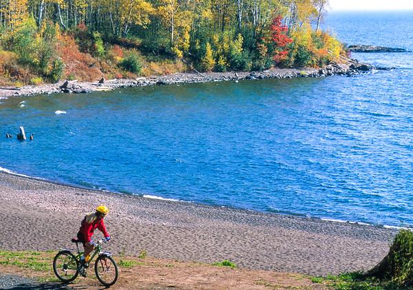 Biker on Minnesota's Gitchi-Gami State Trail, on Lake Superior