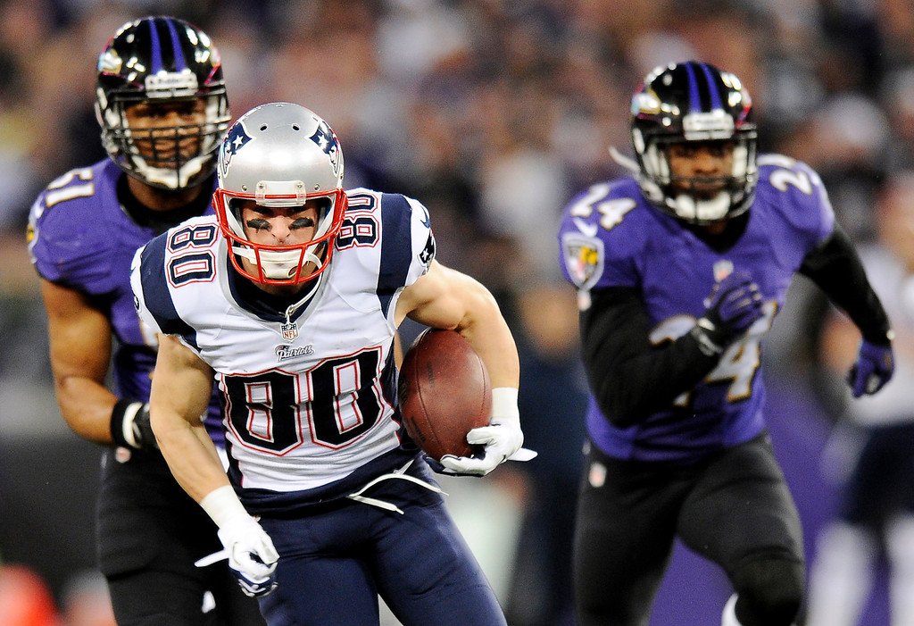 . New England Patriots wide receiver Danny Amendola (80) rushes in front of Baltimore Ravens inside linebacker Daryl Smith, back left, and cornerback Corey Graham in the first half of an NFL football game, Sunday, Dec. 22, 2013, in Baltimore. (AP Photo/Nick Wass)
