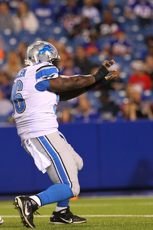 . Detroit Lions defensive tackle Andre Fluellen celebrates after sacking Buffalo Bills quarterback Jordan Palmer during the first half of a preseason NFL football game, Thursday, Aug. 28, 2014, in Orchard Park, N.Y. (AP Photo/Bill Wippert)
