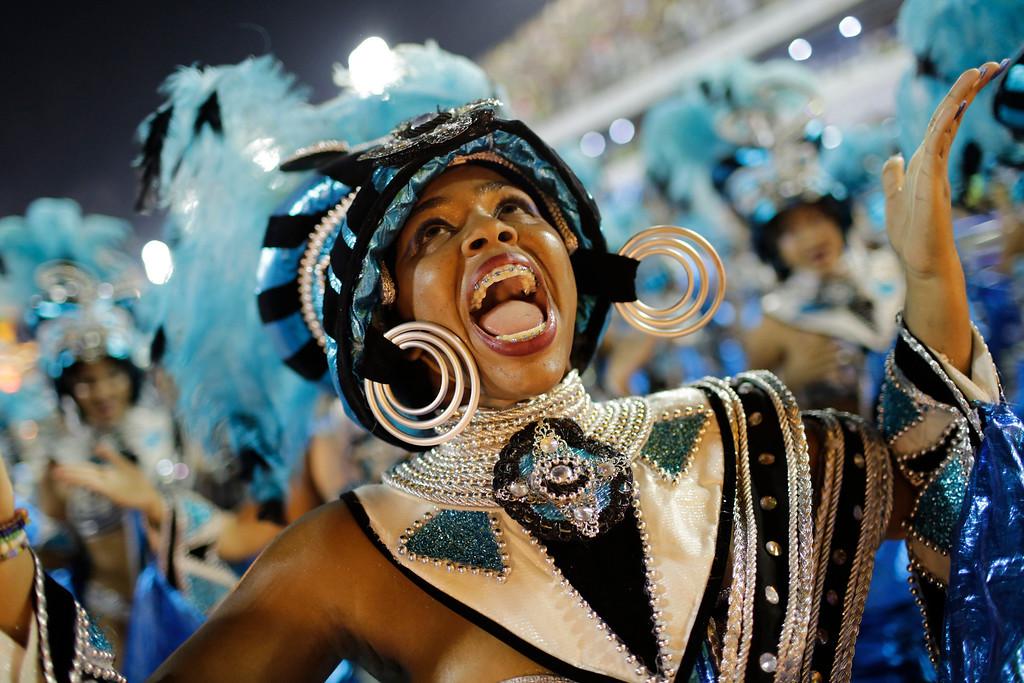 . A performer from the Vila Isabel samba school parades during Carnival celebrations at the Sambadrome in Rio de Janeiro, Brazil, Monday, Feb. 27, 2017. (AP Photo/Silvia Izquierdo)