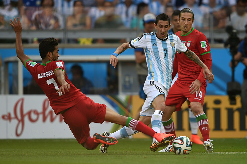 . Iran\'s forward Masoud Shojaei (L), Argentina\'s midfielder Angel Di Maria (C) and Iran\'s midfielder Andranik Teymourian vie for the ball during a Group F football match between Argentina and Iran at the Mineirao Stadium in Belo Horizonte during the 2014 FIFA World Cup in Brazil on June 21, 2014.  (PEDRO UGARTE/AFP/Getty Images)