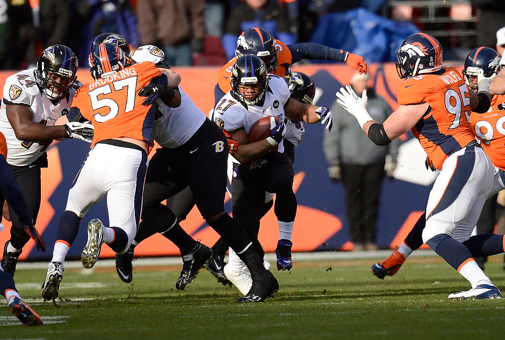 . Baltimore Ravens running back Ray Rice (27) makes a run up the middle in the first quarter. The Denver Broncos vs Baltimore Ravens AFC Divisional playoff game at Sports Authority Field Saturday January 12, 2013. (Photo by Joe Amon,/The Denver Post)