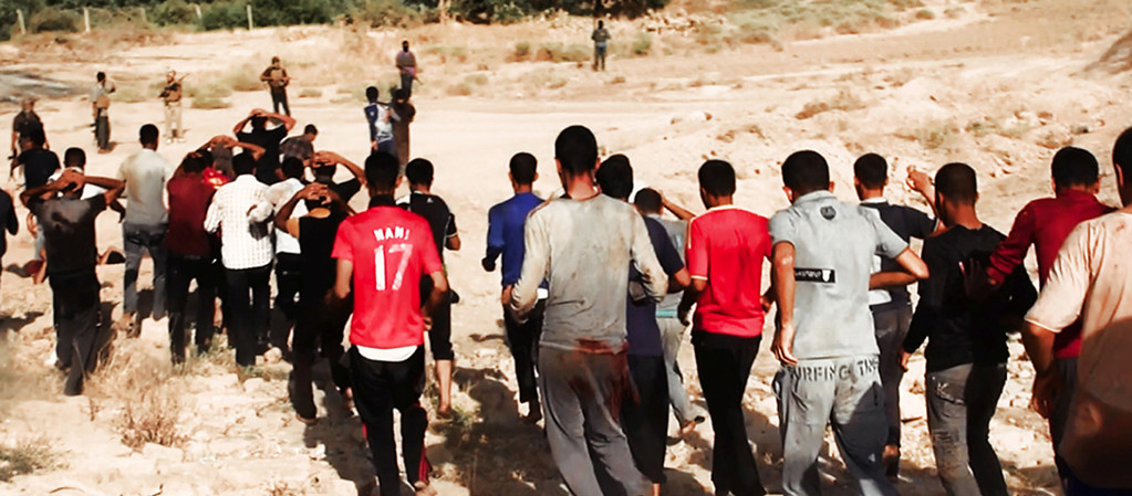 . This image posted on a militant website on Saturday, June 14, 2014, which has been verified and is consistent with other AP reporting, appears to show militants from the al-Qaida-inspired Islamic State of Iraq and the Levant (ISIL) leading captured Iraqi soldiers wearing plain clothes to an open field moments before shooting them in Tikrit, Iraq. The Islamic militant group that seized much of northern Iraq has posted photos that appear to show its fighters shooting dead dozens of captured Iraqi soldiers in a province north of the capital Baghdad. Iraq\'s top military spokesman Lt. Gen. Qassim al-Moussawi confirmed the photosí authenticity on Sunday and said he was aware of cases of mass murder of Iraqi soldiers. (AP Photo via militant website)