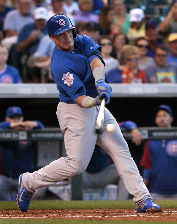 . Chicago Cubs\' Javier Baez bats in the fourth inning of a  baseball game against the Colorado Rockies in Denver on Tuesday, Aug. 5, 2014.(AP Photo/Joe Mahoney)
