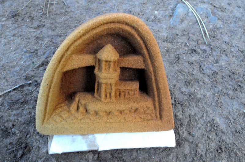 He carves beautiful sculptures of seascapes with simple tools out of sandstone