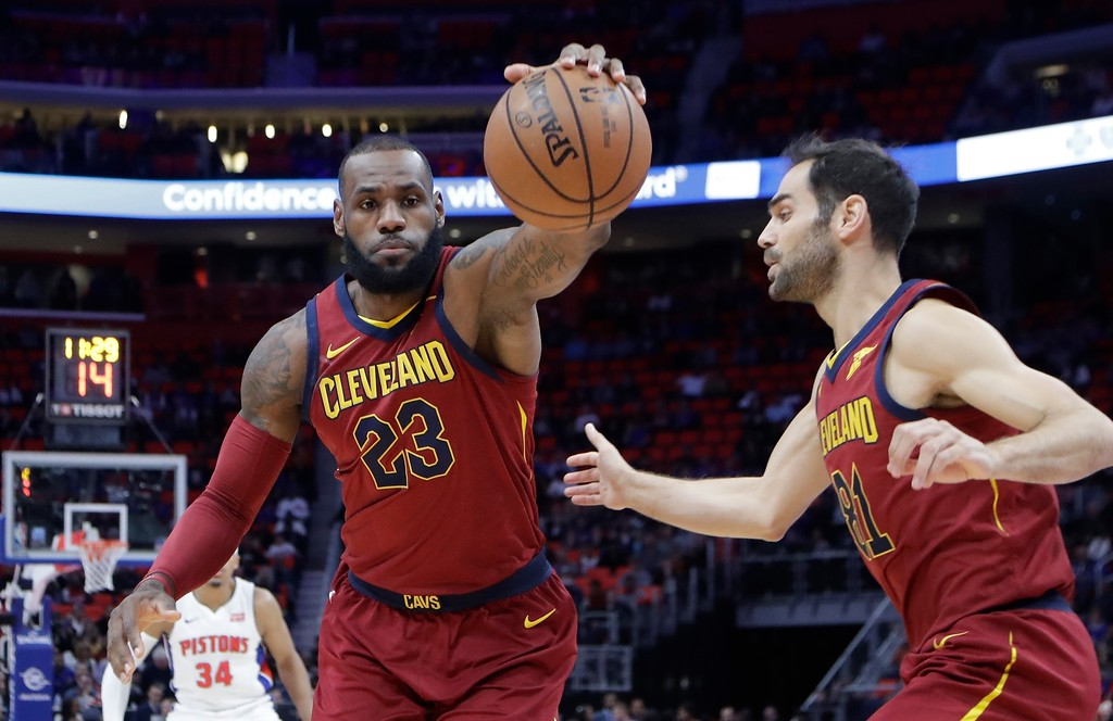 . Cleveland Cavaliers forward LeBron James retrieves a loose ball during the first half of an NBA basketball game against the Detroit Pistons, Monday, Nov. 20, 2017, in Detroit. (AP Photo/Carlos Osorio)