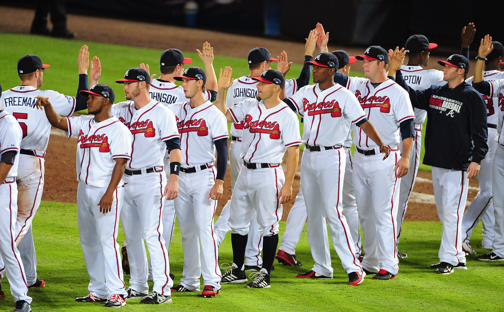 . ATLANTA, GA - OCTOBER 04:  The Atlanta Braves celebrate after defeating the Los Angeles Dodgers during Game Two of the National League Division Series at Turner Field on October 4, 2013 in Atlanta, Georgia.  (Photo by Scott Cunningham/Getty Images)