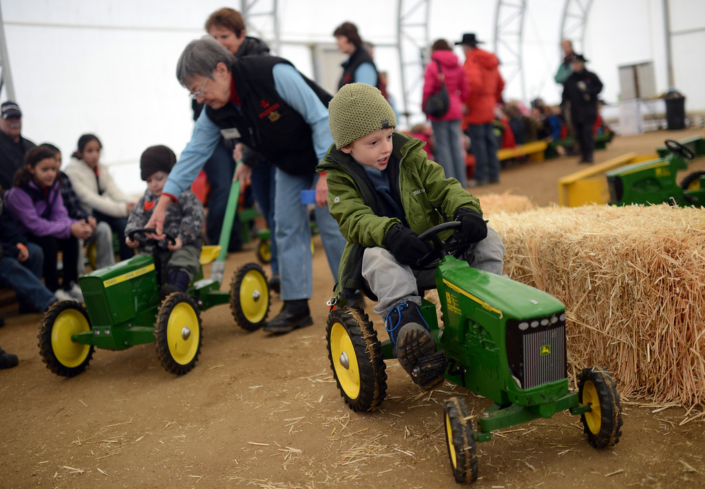 . Asher LeVos, 5, of Evergreen is pedaling during the tractor race at Ames Activity Pavilion of 2013 National Western Stock Show on Tuesday. Denver. CO, January 15, 2013.  Hyoung Chang, The Denver Post