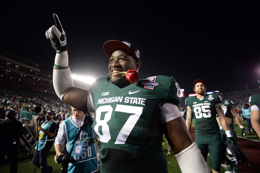 . Michigan State\'s Brandon Clemons #87 walks in the locker room after winning  the 100th Rose Bowl game in Pasadena Wednesday, January 1, 2014. Michigan State defeated Stanford 24-20. (Photo by Hans Gutknecht/Los Angeles Daily News)