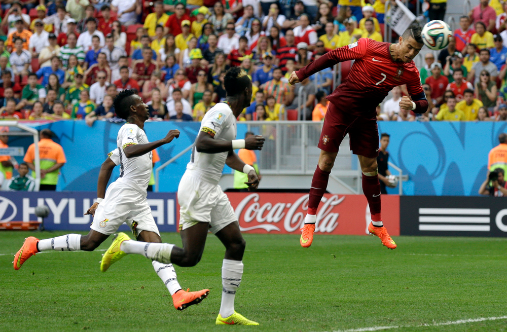 . Portugal\'s Cristiano Ronaldo goes close with a header during the group G World Cup soccer match between Portugal and Ghana at the Estadio Nacional in Brasilia, Brazil, Thursday, June 26, 2014. (AP Photo/Martin Mejia)