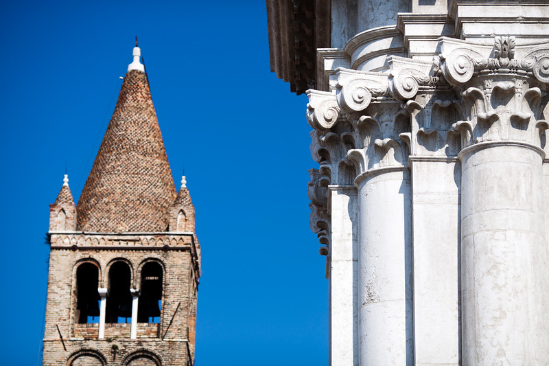 Campanile (bell tower) and detail of the facade, San Barnaba church, Venice, Italy