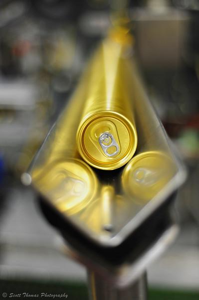 Soda can pop tops loader slide.
