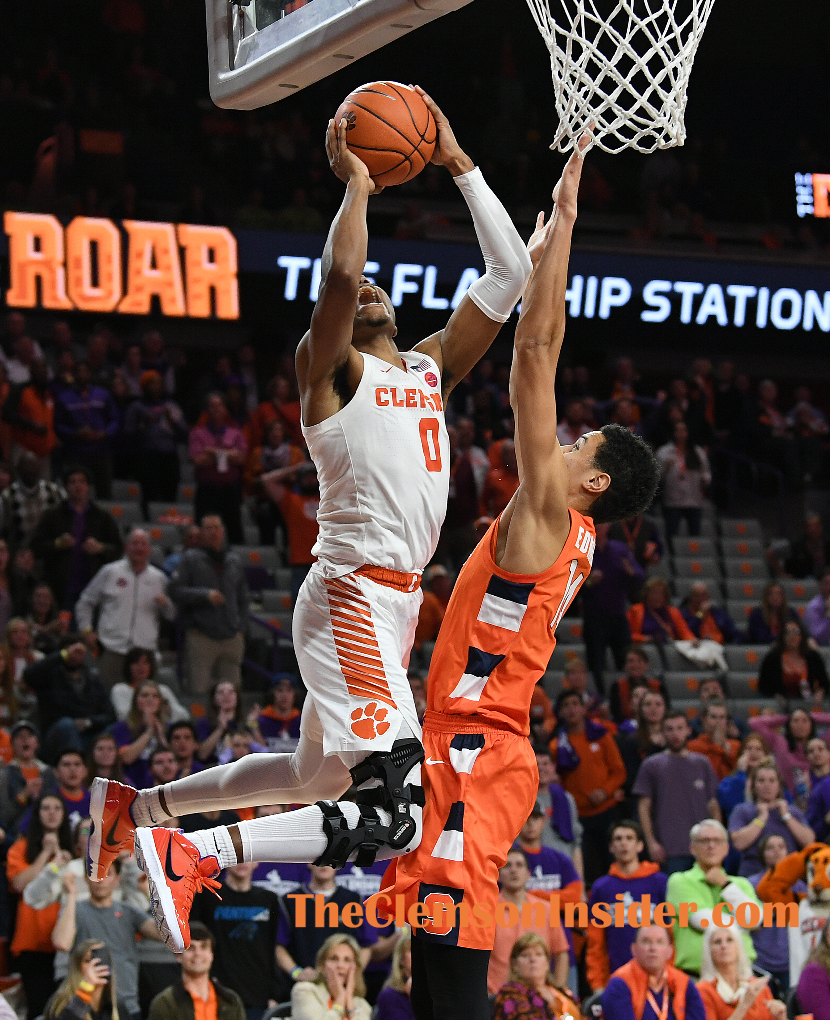 Clemson guard Clyde Trapp (0) scores the winning basket over Syracuse center Jesse Edwards (14) Tuesday, January 28, 2020 at Clemson's Littlejohn Coliseum. Bart Boatwright/The Clemson Insider