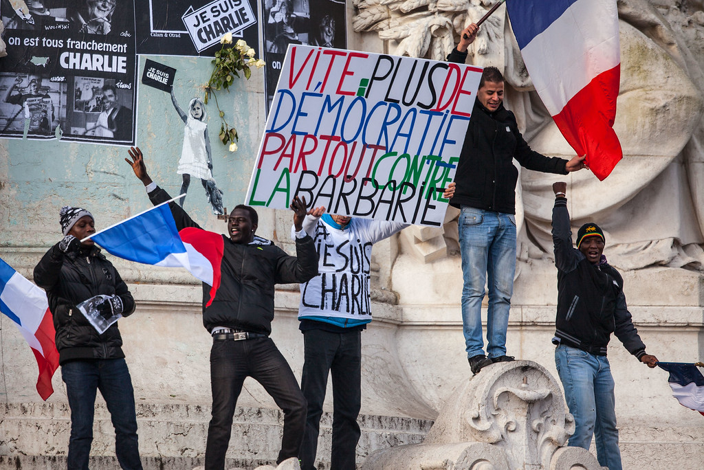 . PARIS, FRANCE - JANUARY 11:  Demonstrators make their way along Place de la Republique during a mass unity rally following the recent terrorist attacks on January 11, 2015 in Paris, France. An estimated one million people have converged in central Paris for the Unity March joining in solidarity with the 17 victims of this week\'s terrorist attacks in the country. French President Francois Hollande led the march and was joined by world leaders in a sign of unity. The terrorist atrocities started on Wednesday with the attack on the French satirical magazine Charlie Hebdo, killing 12, and ended on Friday with sieges at a printing company in Dammartin en Goele and a Kosher supermarket in Paris with four hostages and three suspects being killed. A fourth suspect, Hayat Boumeddiene, 26, escaped and is wanted in connection with the murder of a policewoman.  (Photo by David Ramos/Getty Images)