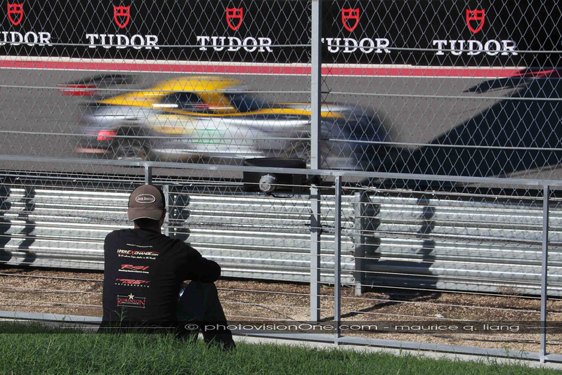 Rick sits by the track to feel the cars race by.