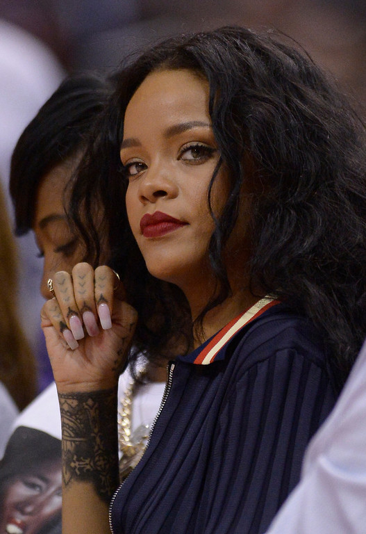 . Rihanna sits on the sidelines. The Oklahoma City Thunder defeated the Clippers 107-101 in a regular season game at Staples Center in Los Angeles, CA. 4/9/2014(Photo by John McCoy / Los Angeles Daily News)