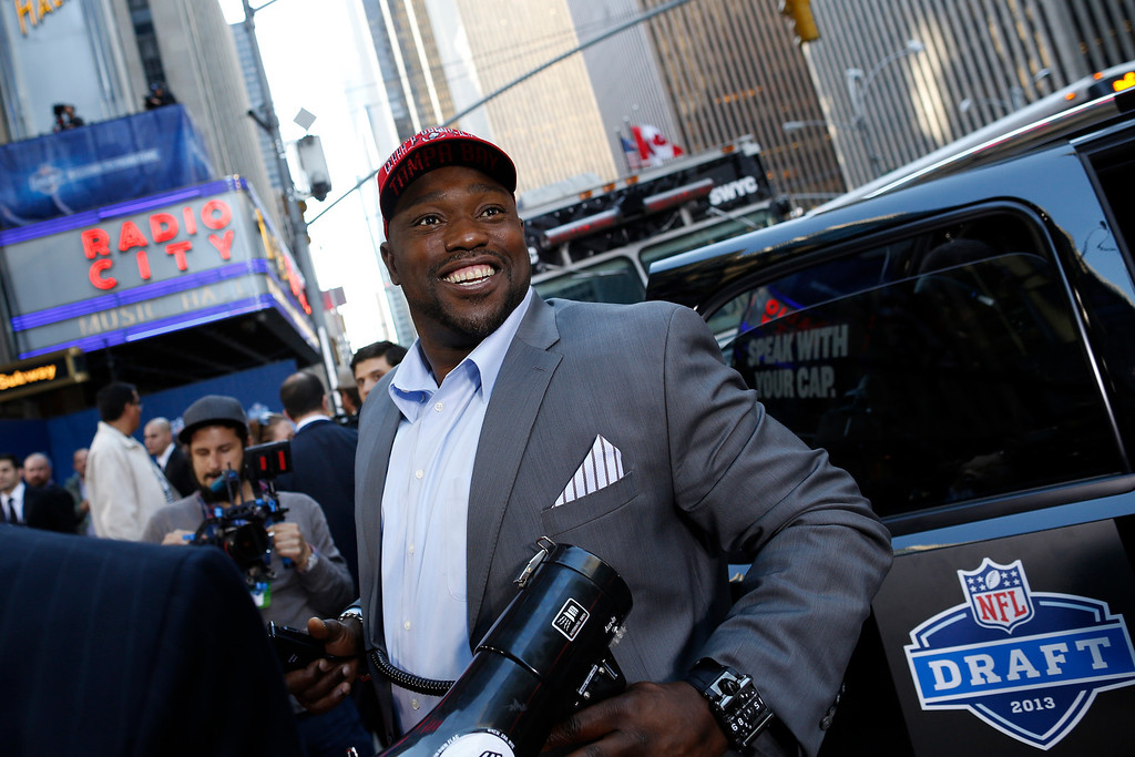 . NFL Network host and newly elected Pro Football Hall of Famer Warren Sapp arrives as fans and media await the official 2013 New Era NFL Draft Caps delivery to Radio City Music Hall, on Thursday April 25, 2013. (John Minchillo/AP Images for New Era Cap)