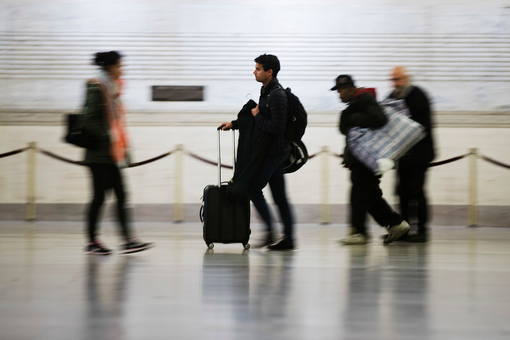 . Travelers make their way through the 30th Street Station ahead of the Thanksgiving Day holiday, in Philadelphia, Tuesday, Nov. 22, 2016. Almost 49 million people are expected to travel 50 miles or more for the holiday, the most since 2007, according to AAA. (AP Photo/Matt Rourke)