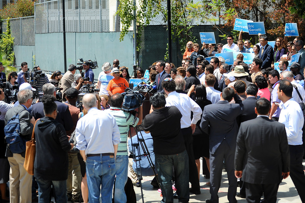 . Eric Garcetti is surrounded by members of the media and supporters during a press conference to discuss the election results at El Centro del Pueblo in Echo Park, CA May 22, 2013.  Eric Garcetti won the mayoral runoff Tuesday in Los Angeles.(Andy Holzman/Staff Photographer)