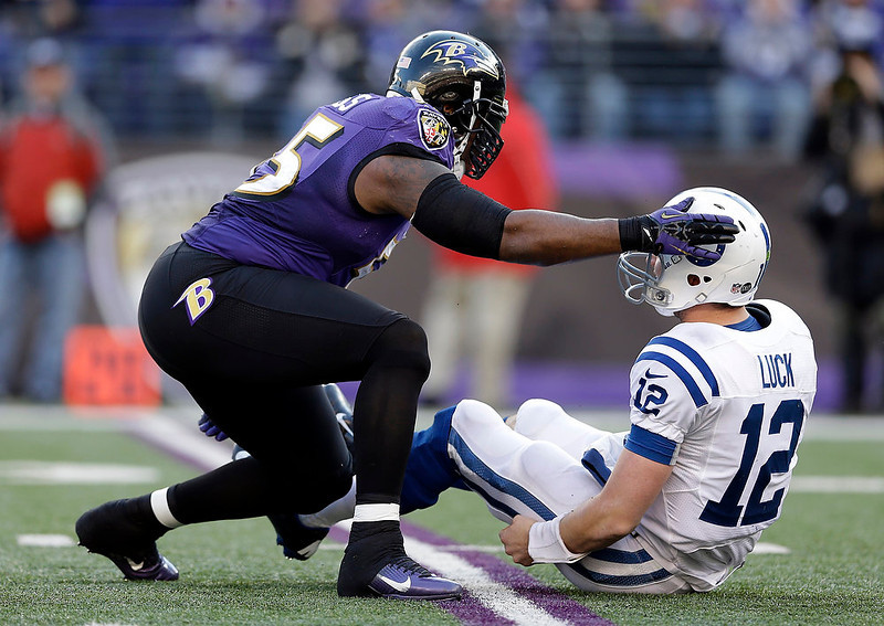 . Baltimore Ravens outside linebacker Terrell Suggs (55) taps Indianapolis Colts quarterback Andrew Luck (12) on the helmet after a hit, during the second half of an NFL wild card playoff football game Sunday, Jan. 6, 2013, in Baltimore. (AP Photo/Patrick Semansky)