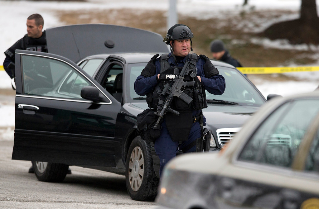 . Police walk on the scene after a shooting at The Mall in Columbia on Saturday, Jan. 25, 2014 in Columbia, Md. Police say three people died in a shooting at the mall in suburban Baltimore, including the presumed gunman.(AP Photo/ Evan Vucci)