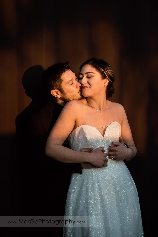 groom kissing bride's cheek at Mt Hamilton GrandView Restaurant in San Jose