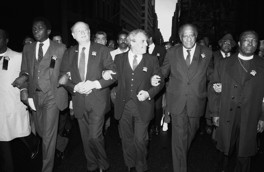 ". A procession on ""National Day of Mourning\""  is led on Fifth Avenue in New York on Saturday, Oct. 5, 1985.  Leaders in the procession are marching in protest of apartheid in South Africa.  Marchers are  from left: Oumarou G. Youssoufou, ambassador for the Organization of African Unity to the United Nations; New York\'s Mayor Ed Koch; National Association for the Advancement of Colored People\'s Director Dr. Benjamin Hooks; and New York\'s Police Commissioner Benjamin Ward. The group made its way to an ecumenical prayer service at Patrick\'s Cathedral.   (AP Photo/Rick Maiman)"