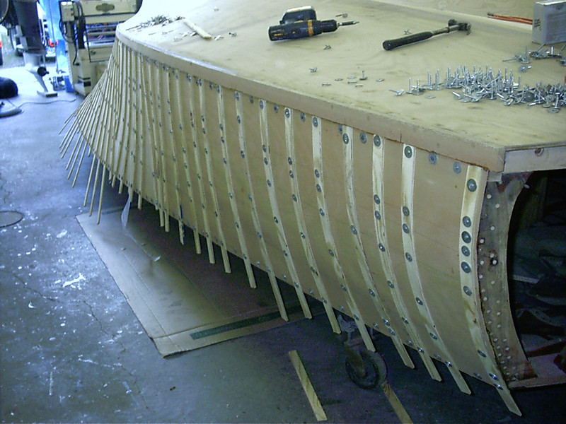 starboard rear plywood glued in place with tempory fasteners.