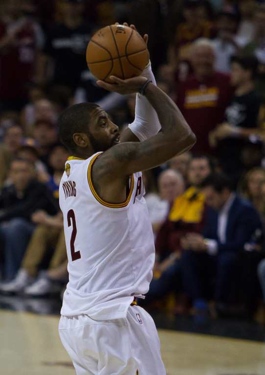 . Kyrie Irving of the Cleveland Cavaliers takes a jump shot during game 4 of the NBA Finals against the Golden State Warriors at the Quicken Loans Arena on June 10, 2017.  The Cavs defeated the Warriors 137-116.