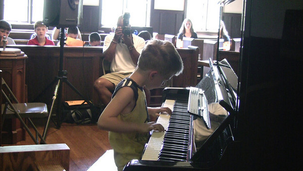 "June 2010.  Peter performs at annual MMM recital in Medfield: ""For Elise"" by Beethoven ""Blue Danube"" by Strauss ""Arabian dance"" by Tchaikovsky ""Quiet Ocean"" by Peter"