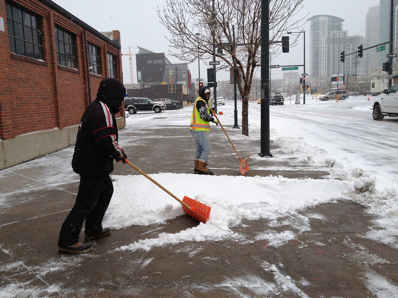. Clearing the sidewalks on 21st street downtown. (Denver Post Joe Amon)
