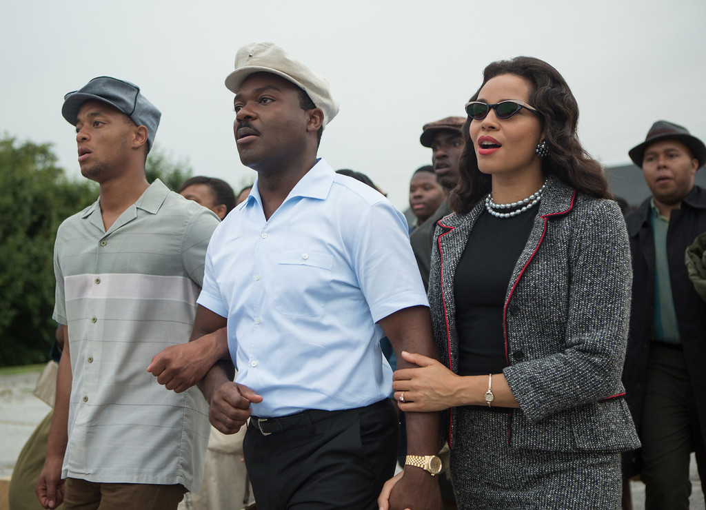 """. This photo released by Paramount Pictures shows, David Oyelowo, center, as Martin Luther King, Jr. and Carmen Ejogo, right, as Coretta Scott King in the film, \""""Selma.\""""  The film was nominated for a Golden Globe for best drama on Thursday, Dec. 11, 2014. The 72nd annual Golden Globe awards will air on NBC on Sunday, Jan. 11. (AP Photo/Paramount Pictures, Atsushi Nishijima)"""