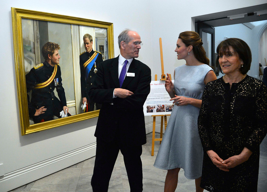 . Catherine, Duchess of Cambridge views a painting of her husband Prince William and brother-in-law Prince Harry accompanied by National Portrait Gallery director Sandy Nairne (L) and Art Room charity founder Juli Beattie (R) during an evening reception to celebrate the work of The Art Room charity at The National Portrait Gallery on April 24, 2013 in London, England.  (Photo by Toby Melville/WPA Pool/Getty Images)